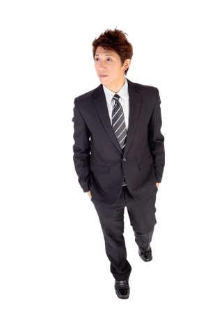 Confident executive walking, full length portrait isolated on white. Stock Photo - 8068588