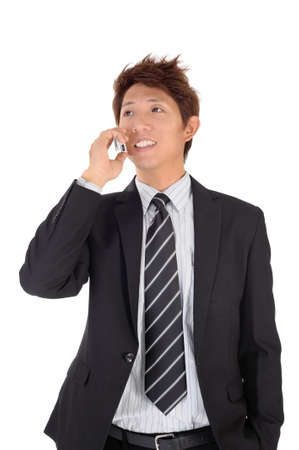 Young entrepreneur talking on phone with smiling expression over white background. photo