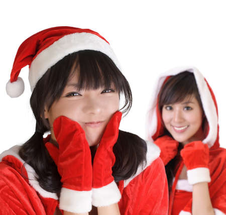 Young Christmas girls smiling with happy expression over white background. photo