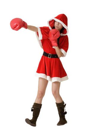 Christmas lady fighting, full length portrait isolated on white. photo