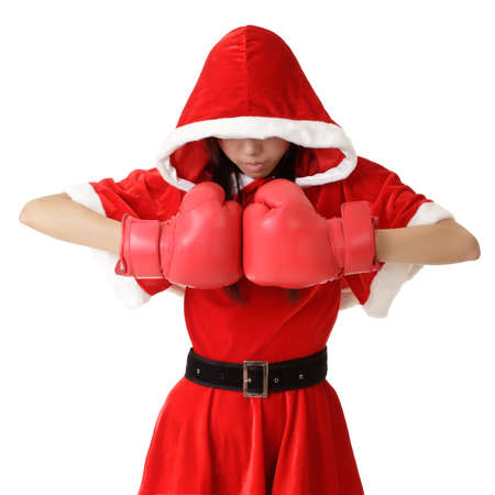 Christmas girl with boxing gloves posing over white background. photo