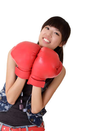 Young woman on boxing gloves with smiling expression looking at you over white. photo