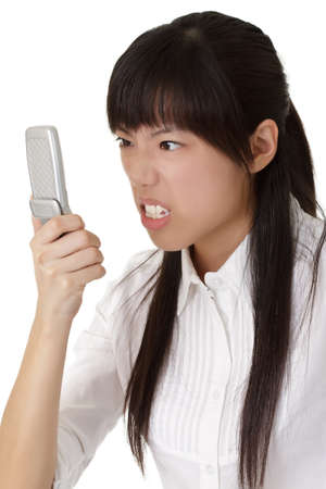 choleric: Angry business woman staring cellphone with expression of anger. Stock Photo