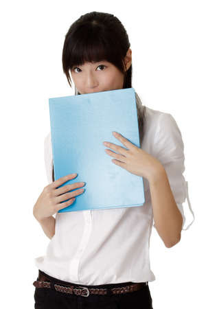 shy woman: Young and shy business woman put document on face. Stock Photo