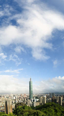 Cityscape of Taipei with famous landmark, 101 skyscraper, under white clouds and blue sky. Vertical panoramic city scenery. Stock Photo - 8212206