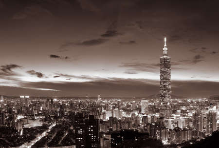 Cityscape of Taipei with famous 101 skyscraper and buildings in night in Taiwan.