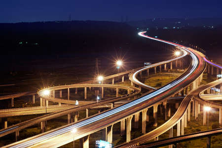 junction: Highway in night with cars light in modern city in Taiwan, Asia. Stock Photo
