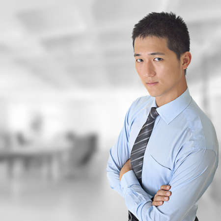 asian man face: Young business man of Asian looking at you in office.