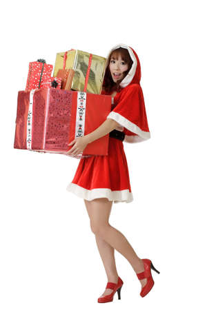 Happy Christmas woman with gifts isolated over white. Stock Photo - 8212218