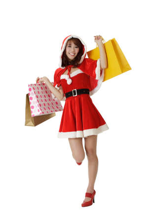 Happy shopping Christmas woman with bags isolated over white. photo