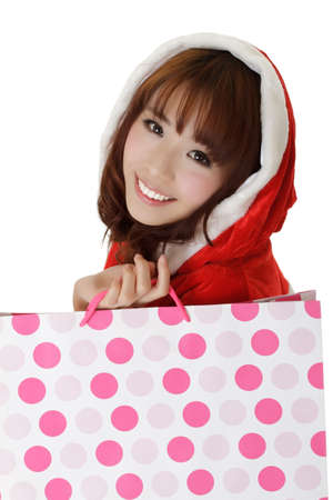 Attractive shopping girl in Christmas clothes showing smiling face. Stock Photo - 8212221