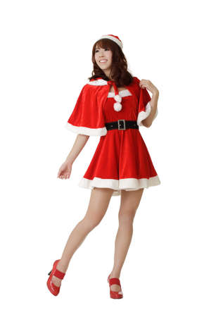 Attractive and sexy young Asian Christmas girl posing isolated over white. photo
