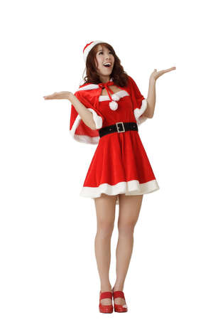 Surprised Christmas girl, full length portrait isolated on white background. photo