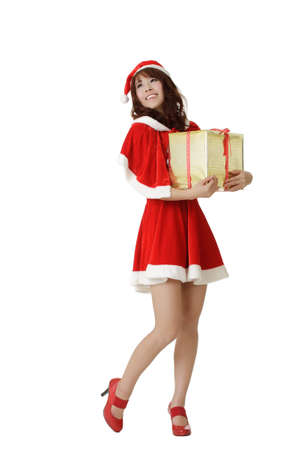 Happy Christmas girl holding gift with smiling isolated over white. photo