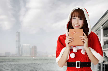 Asian christmas woman holding gift in Hong Kong, Asia. photo