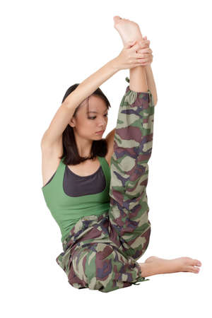 strong light: Young girl of Asian doing stretch excise isolated over white.