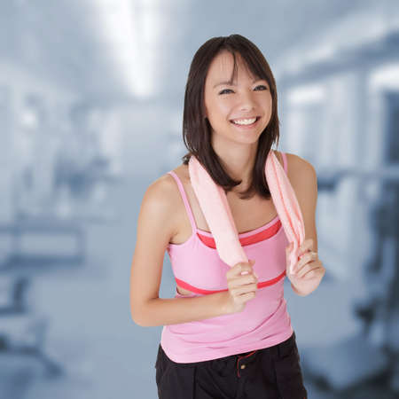 Fit woman portrait of Asian in gym. photo