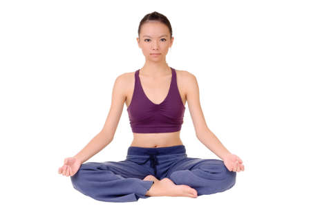 body posture: yoga pose by young Asian woman sitting on ground isolated over white.