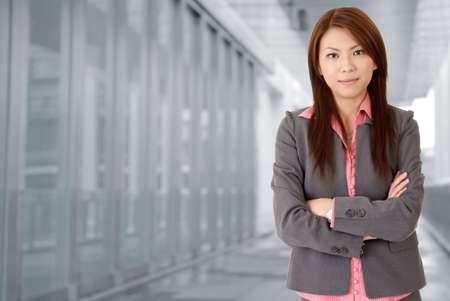 Young attractive business woman in corridor of modern building in outdoor. photo