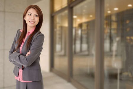 job satisfaction: Young attractive business woman with smiling expression.