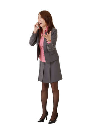 Surprised business woman in phone, full length portrait isolated over white. Stock Photo - 8285508