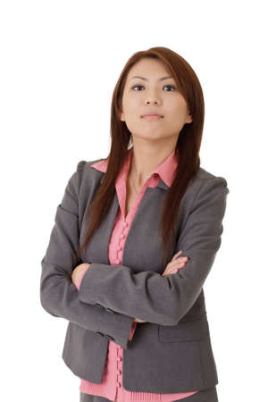 Confident young executive of Asian with proud expression over white. Stock Photo