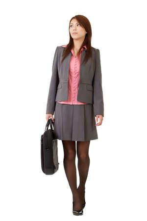 Young business woman holding briefcase and walking isolated over white. Stock Photo - 8285631