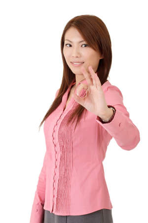 Ok gesture showing by attractive Asian business woman over white. Stock Photo - 8285636