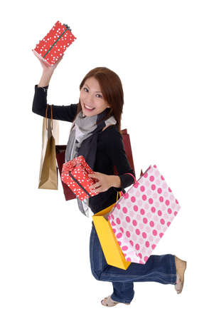 Happy smiling woman holding presents and dancing isolated over white. Stock Photo - 8285597