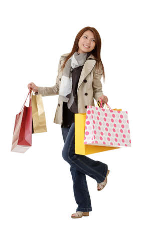 excite: Happy shopping woman holding bags isolated over white. Stock Photo