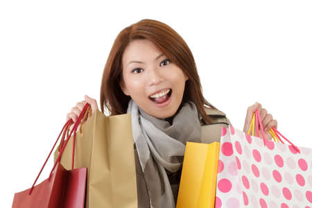 Closeup portrait of happy shopping woman holding bags over white. Stock Photo - 8285740