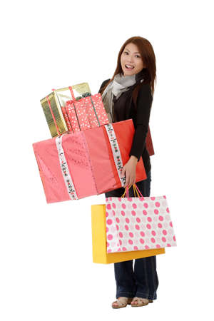 Happy woman holding gifts and bags isolated over white. Stock Photo - 8285731