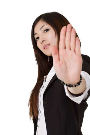 Cool business woman showing reject gesture over white. Stock Photo - 8285750