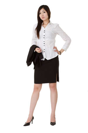 Attractive business woman holding coat and standing over white. Stock Photo