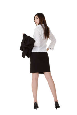 Modern business woman stand with his back to you, isolated over white. photo