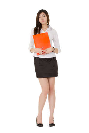 Sexy business woman holding file folder, full length portrait isolated over white. photo