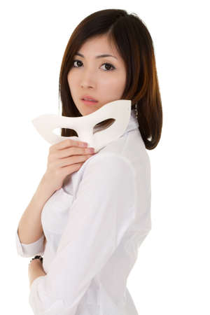 seductive expression: Attractive business woman holding mask with mysterious expression over white.