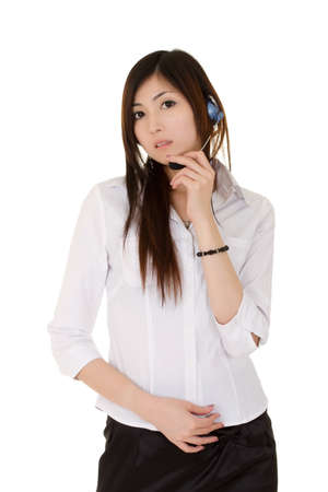 Call center, young Asian beautiful woman with headphone looking at you over white. Stock Photo - 8355327