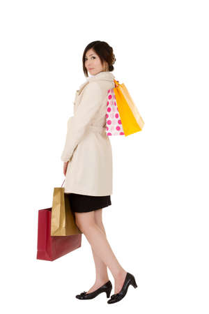 Young lady shopping, full length portrait isolated over white. Stock Photo - 8355317
