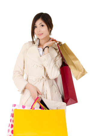 Closeup portrait of young business woman holding bags and shopping over white. Stock Photo - 8355299