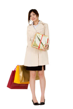 Business woman holding bags and gifts isolated over white. Stock Photo - 8355320