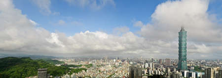 taiwan scenery: Taipei city skyline with famous 101 skyscraper building under white clouds and blue sky in Taiwan. Horizontal panoramic cityscape. Editorial