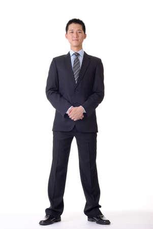 Asian business man, full length portrait on white background.