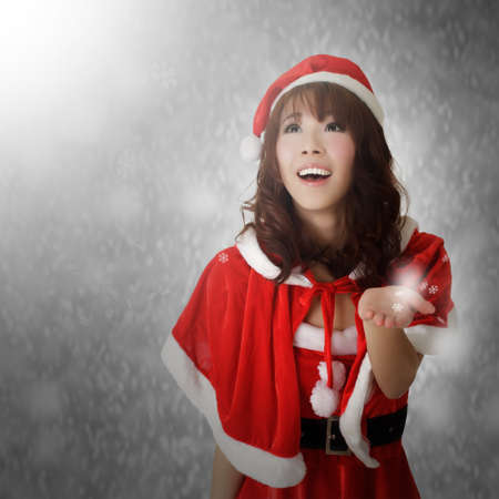 Christmas lady with happy and smiling face watching snowflakes. Stock Photo