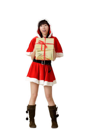 Christmas woman holding gift with surprised expression, full length portrait isolated on white. photo