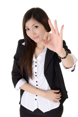 Business woman give you excellent sign over white background. photo