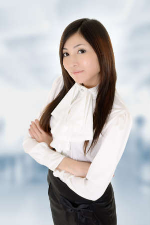presumptuous: Successful business woman with confident expression in office. Stock Photo