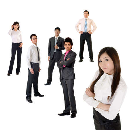 Young business woman and her team over white background, focus on woman in front.