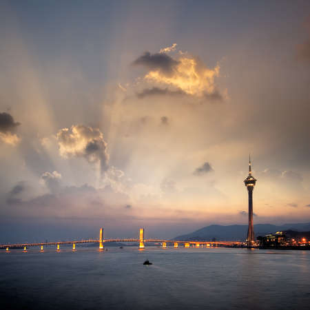 macau: Cityscape of Macau with bridge and tower under sunset in Macao, Asia.