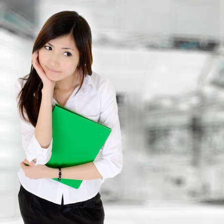 Thinking expression by Asian business woman in office. photo
